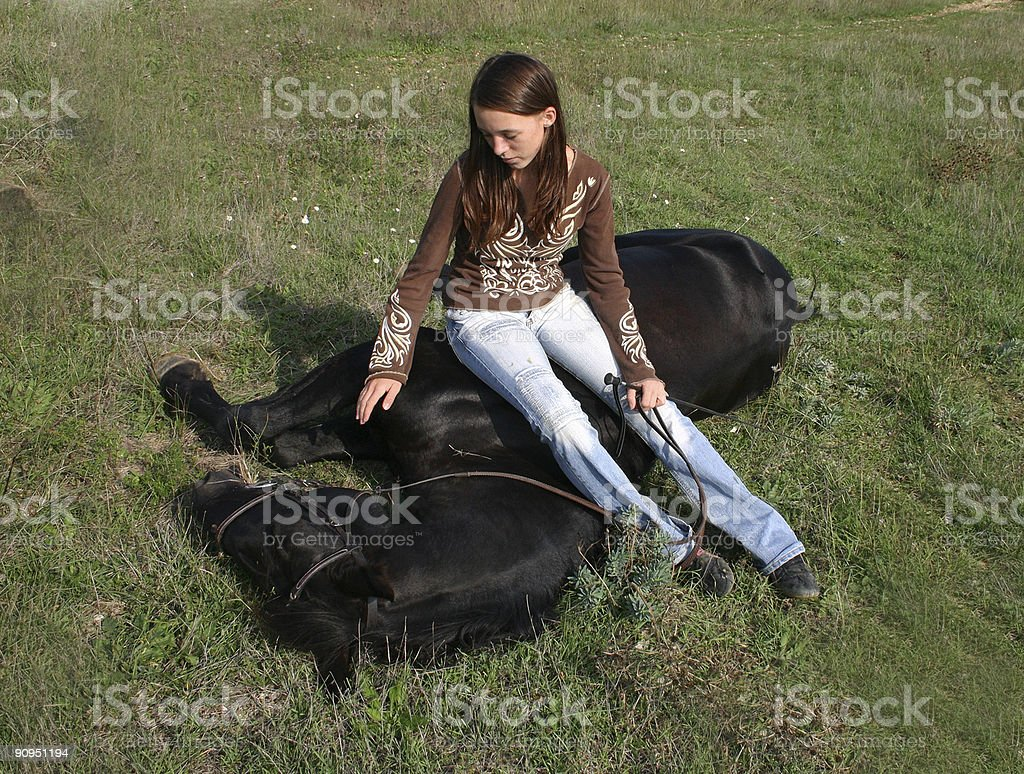 horse laid down and teenager stock photo