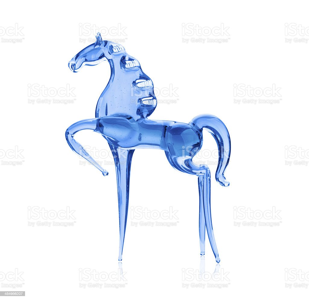 Horse out of the blue glass, isolated on white background royalty-free stock photo