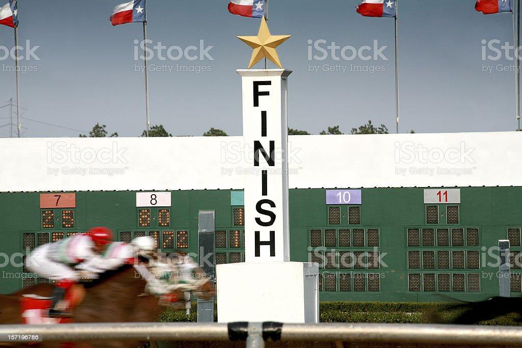 Horse racing. Race track finish line. stock photo
