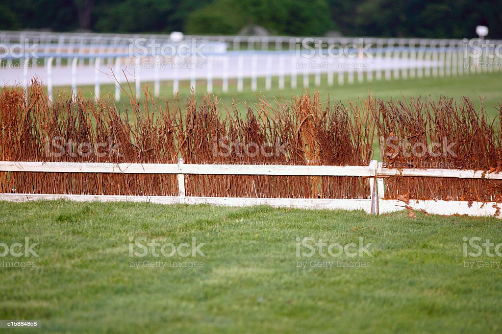 Horse racing training tracks with fence barriers stock photo