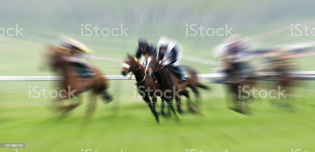 Horse Racing with Blur in the Race Horse and Jockies royalty-free stock photo