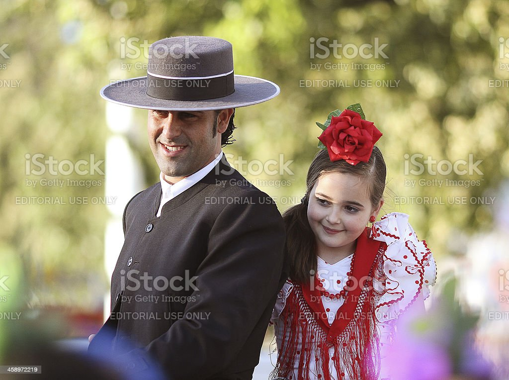 horse rider and little girl in flamenco dress stock photo