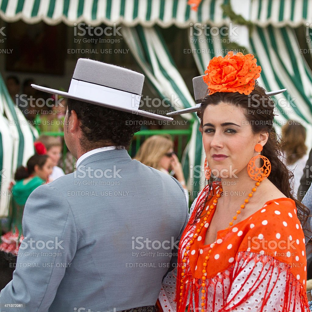 horse rider and woman in flamenco dress stock photo