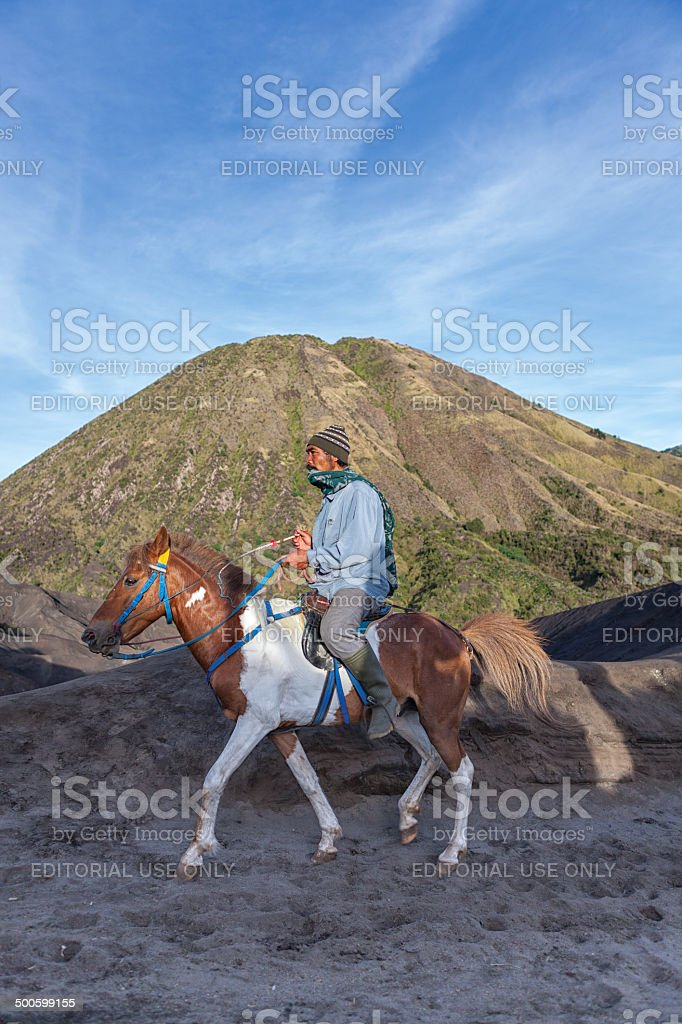 Horse Rider in Mount Bromo stock photo