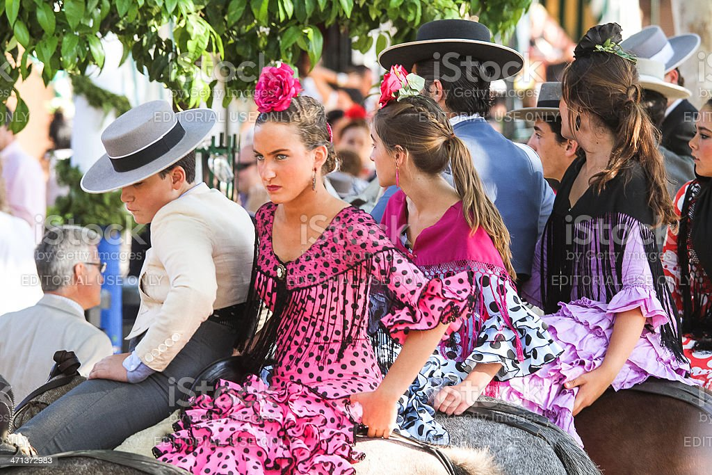 horse riders and girls in flamenco dress stock photo