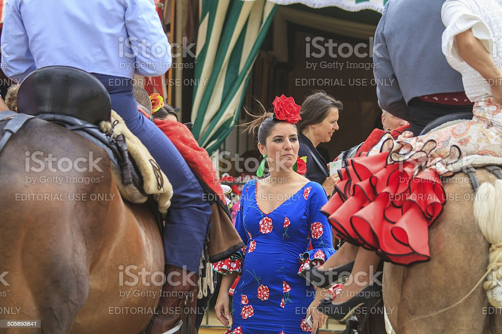 Horse riders and woman in flamenco dress royalty-free stock photo