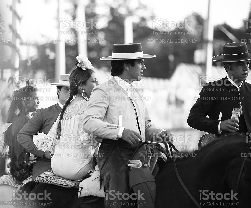 horse riders and women in flamenco dress royalty-free stock photo