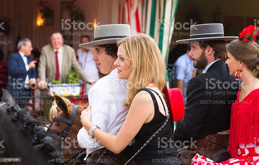 horse riders and women in flamenco dress stock photo