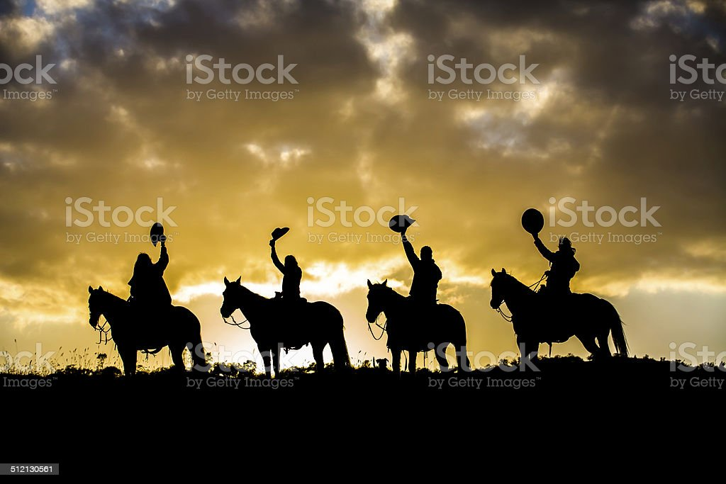 Horse Riders on Ridge stock photo