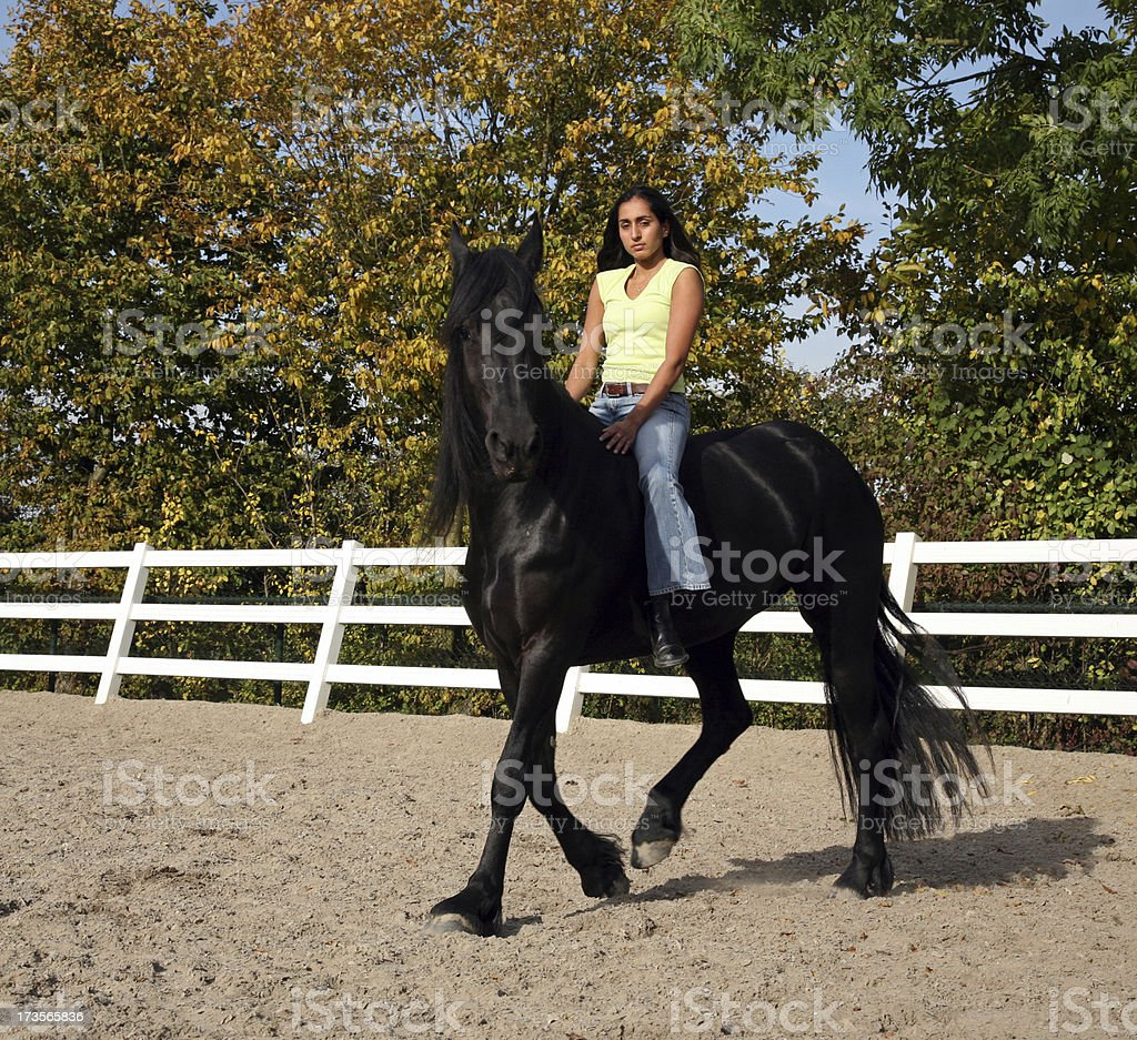 Horse riding in regular jeans stock photo