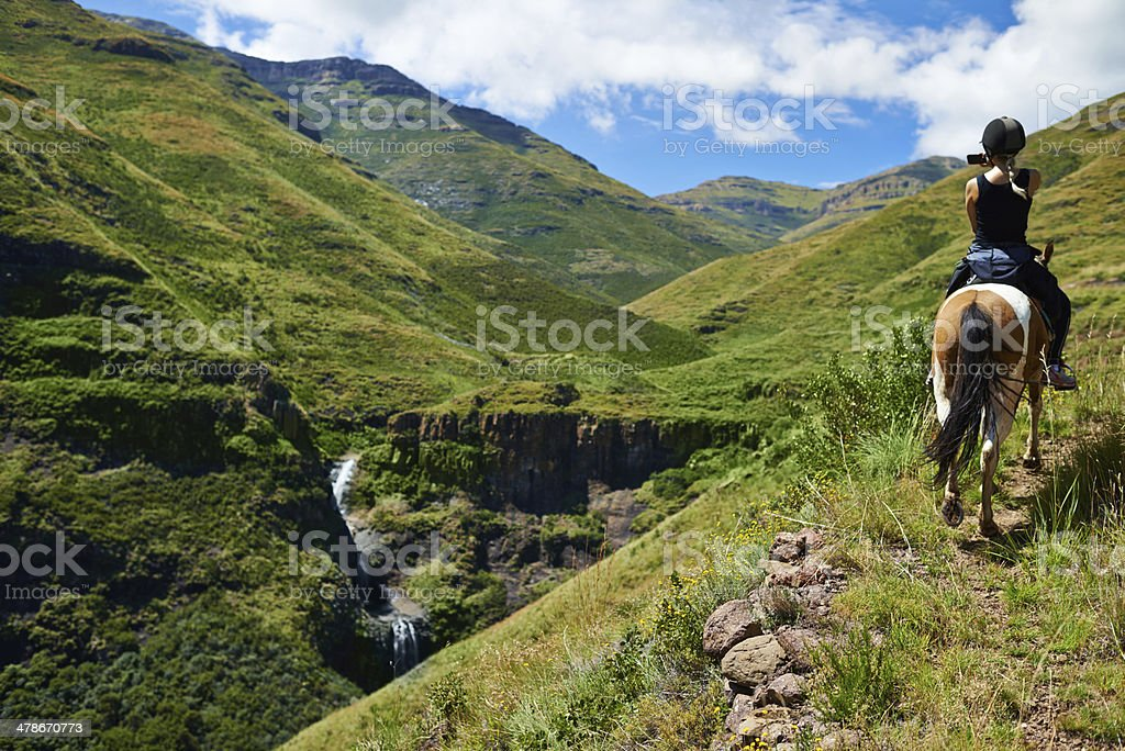 Horse riding in the mountains stock photo