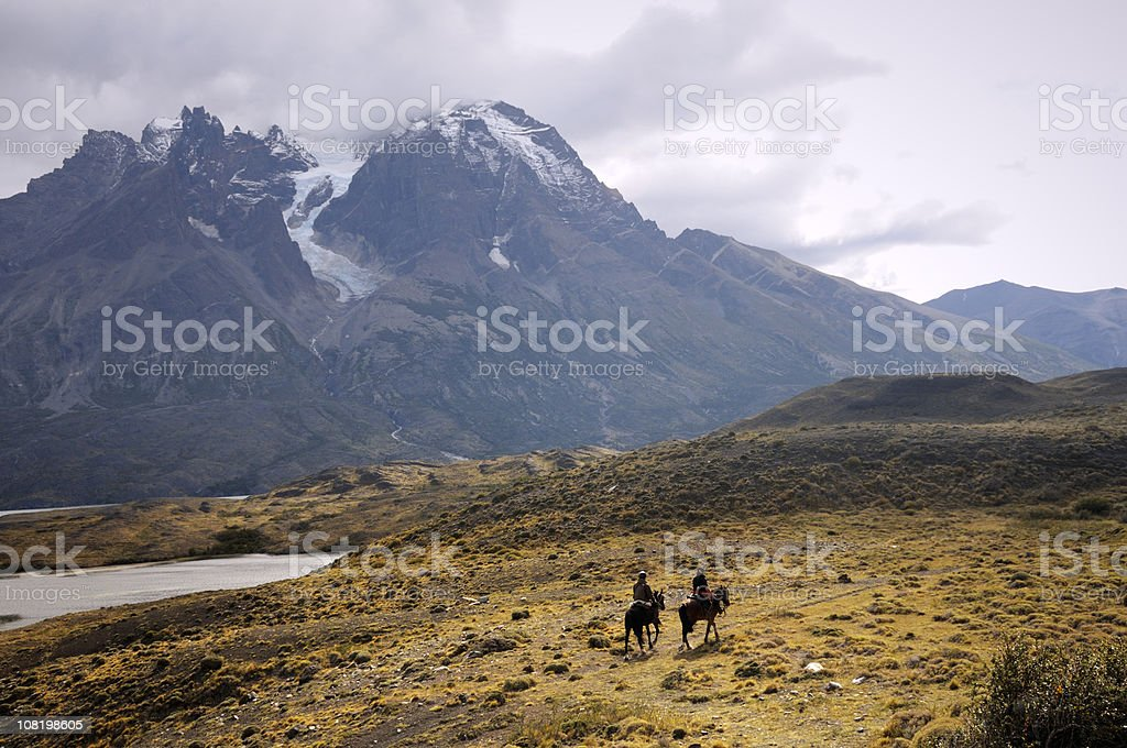 Horse Riding in Torres Del Paine National Park, Patagonia, Chile stock photo