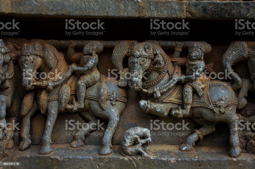 Horse sculptures on the wall panel relief and molding frieze in horizontal treatment in Chennakesava Temple, Somanathapura, Asia stock photo