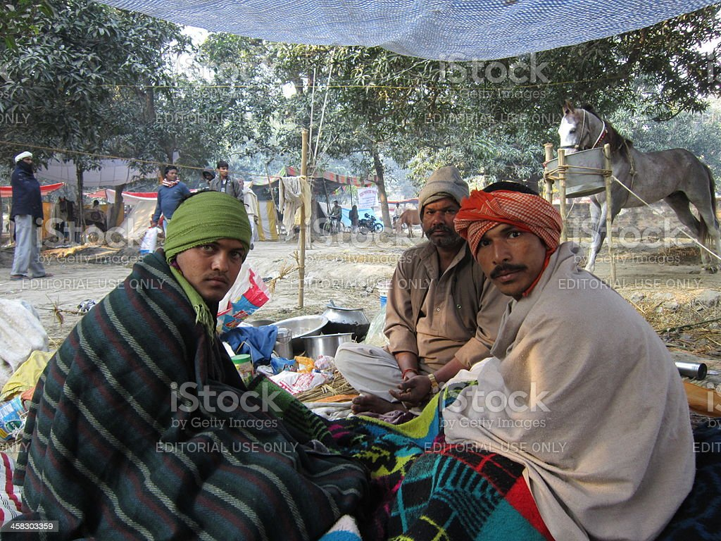 Horse sellers are resting at makeshift tent in Indian fair. royalty-free stock photo