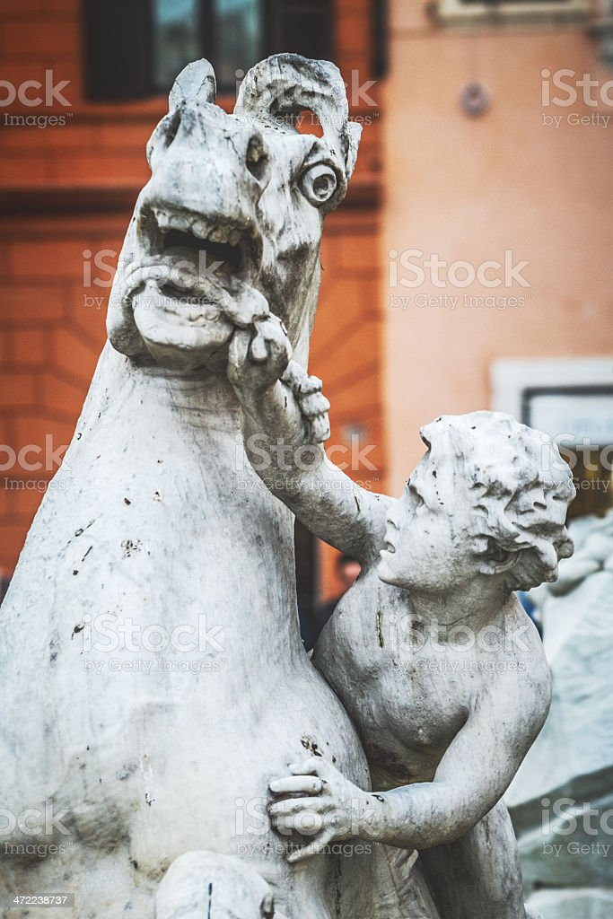 Horse Statue and Child at Piazza Navona stock photo