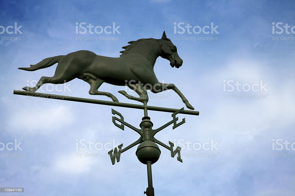 Horse Weathervane against a pretty blue sky stock photo