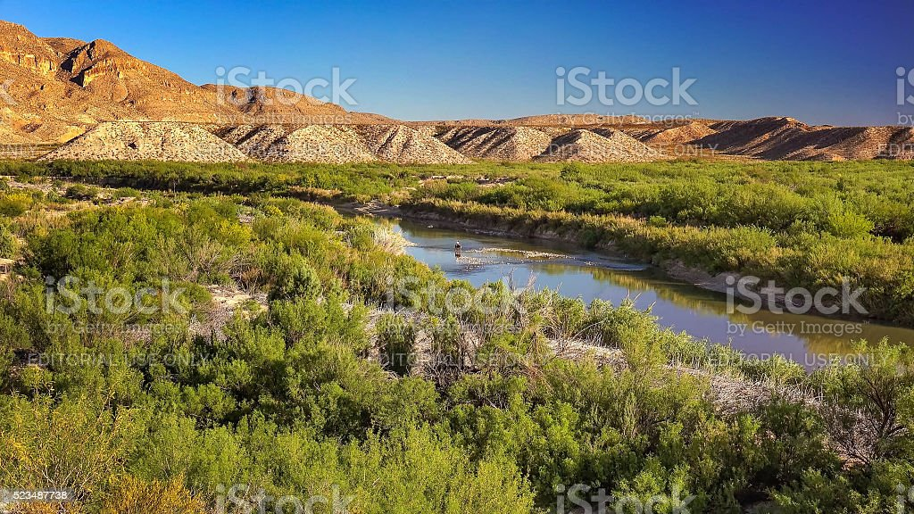 Horseback in Rio Grande River at Big Bend National Park stock photo