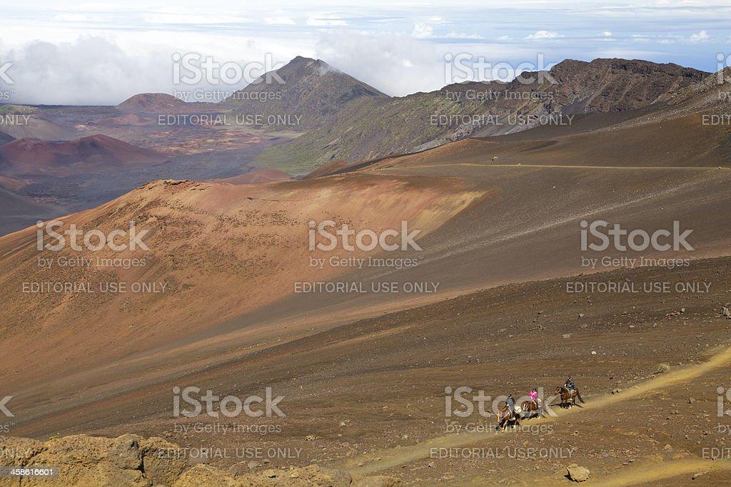 Horseback riders on Haleakala trail, Maui, Hawaii royalty-free stock photo