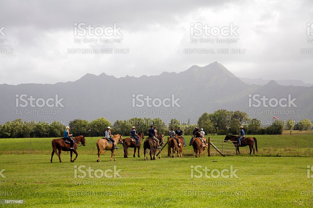 Horseback Riding And The Ever Changing Weather Of Kauai stock photo