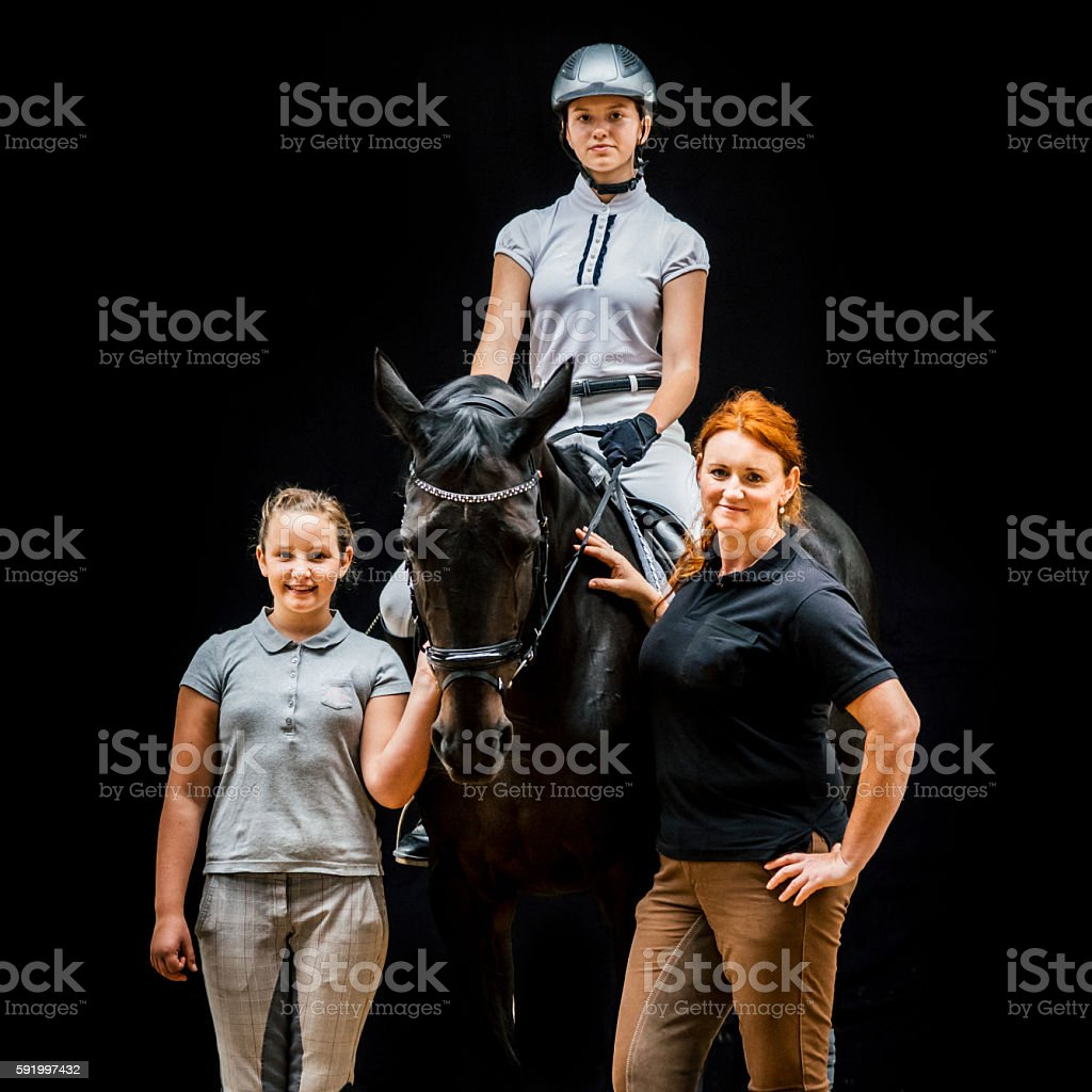 Horseback Riding Family, Mother and Daughters with Horse Together Portrait stock photo