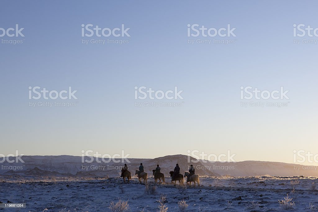 Horseback Riding in Iceland at Winter stock photo