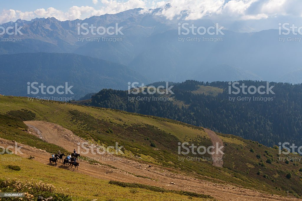 Horseback riding in the Caucasian mountains stock photo