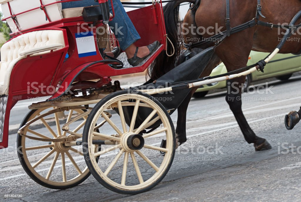 Horse-drawn carriage running in the old town. stock photo