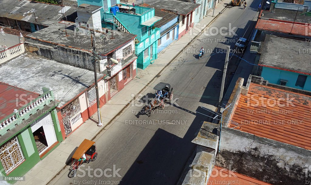 Horse-drawn cart, motorcycle and bicycle taxi on street stock photo
