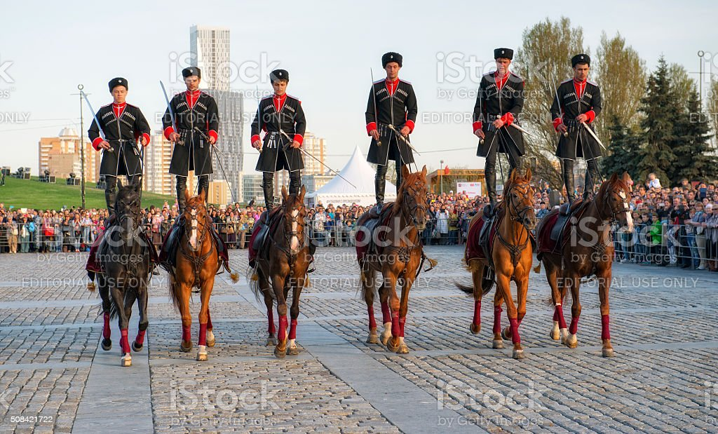 Horsemen Cavalry Escort of the Presidential Regiment perform trick riding stock photo