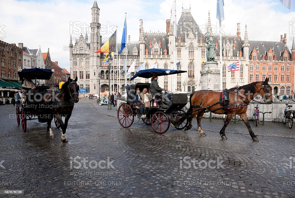 Horses and carriages in Bruges, Belgium stock photo