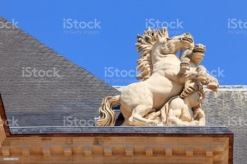 horses angle on the roof of Hotel National des Invalides stock photo