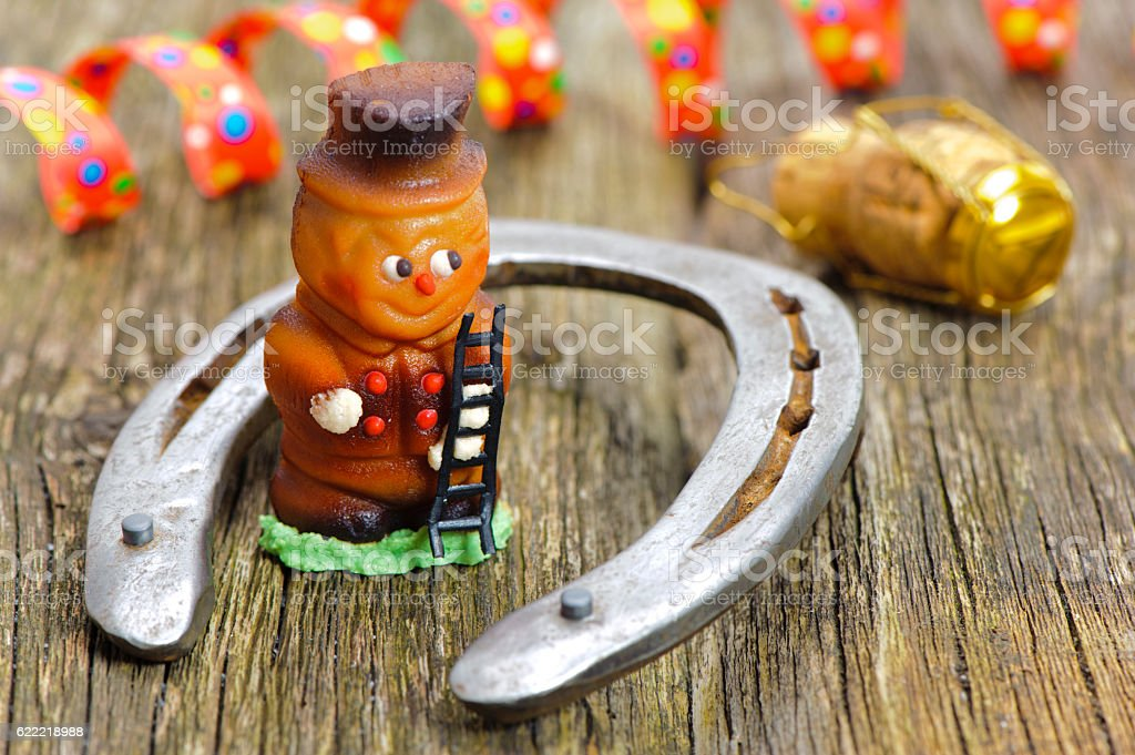 horseshoe and chimney sweeper as talisman for new year stock photo