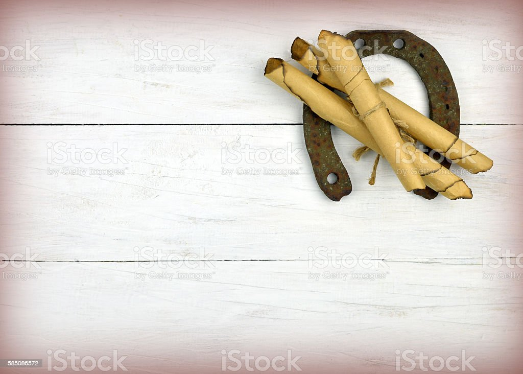 Horseshoe and letters. The ancient way of life. stock photo