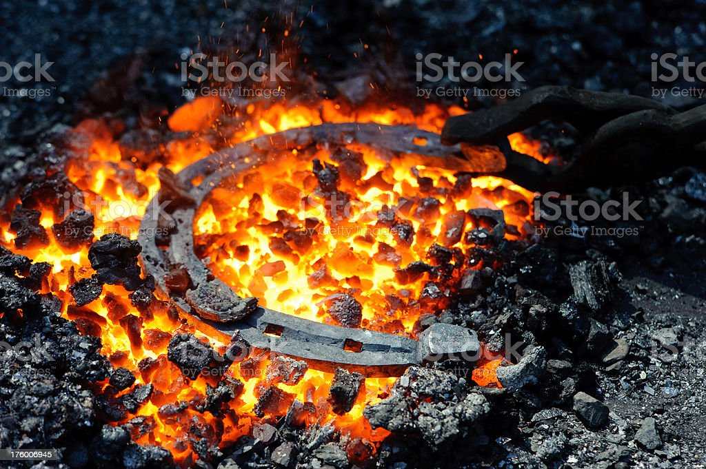 Horseshoe in the coals and flames royalty-free stock photo