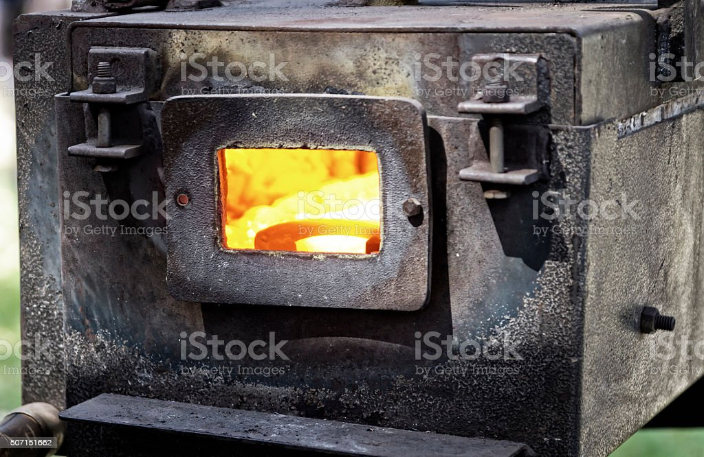 Horseshoe in the furnace stock photo