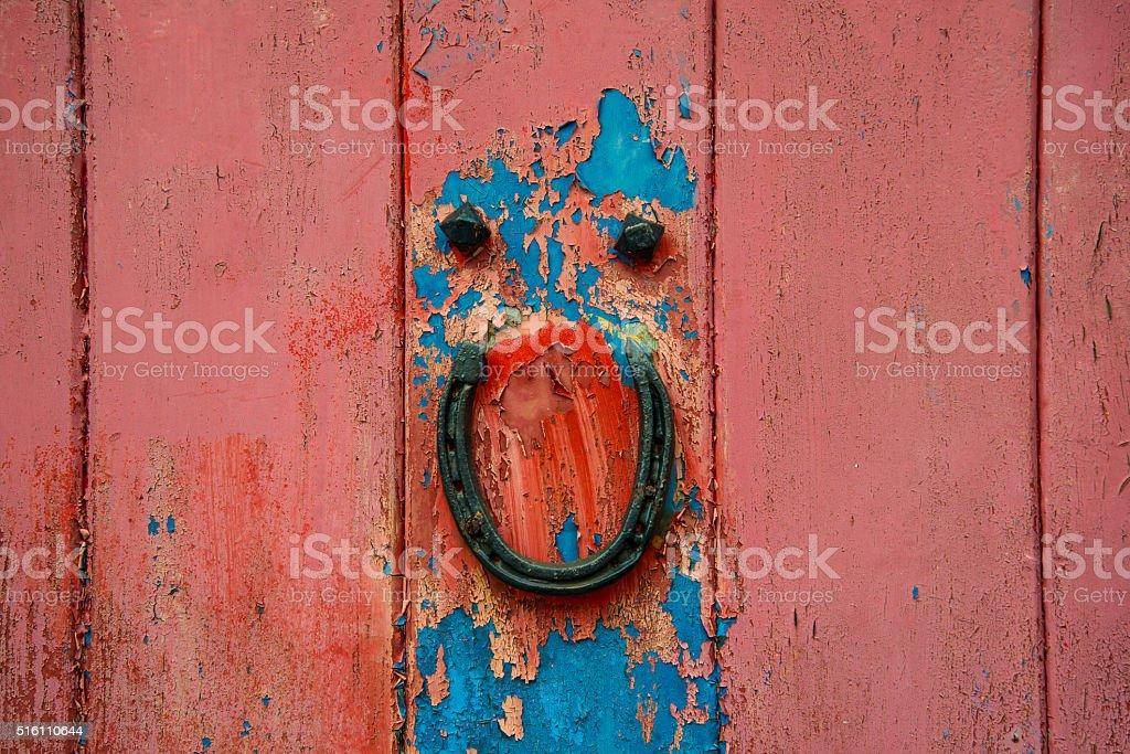 Horseshoe on an old door. stock photo