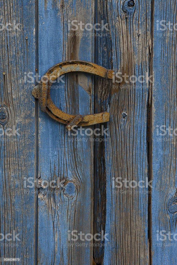 horseshoe on barn wood wall royalty-free stock photo