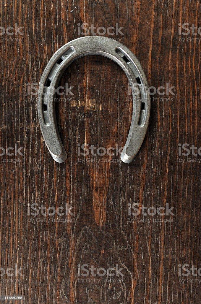 Horseshoe On Wood royalty-free stock photo