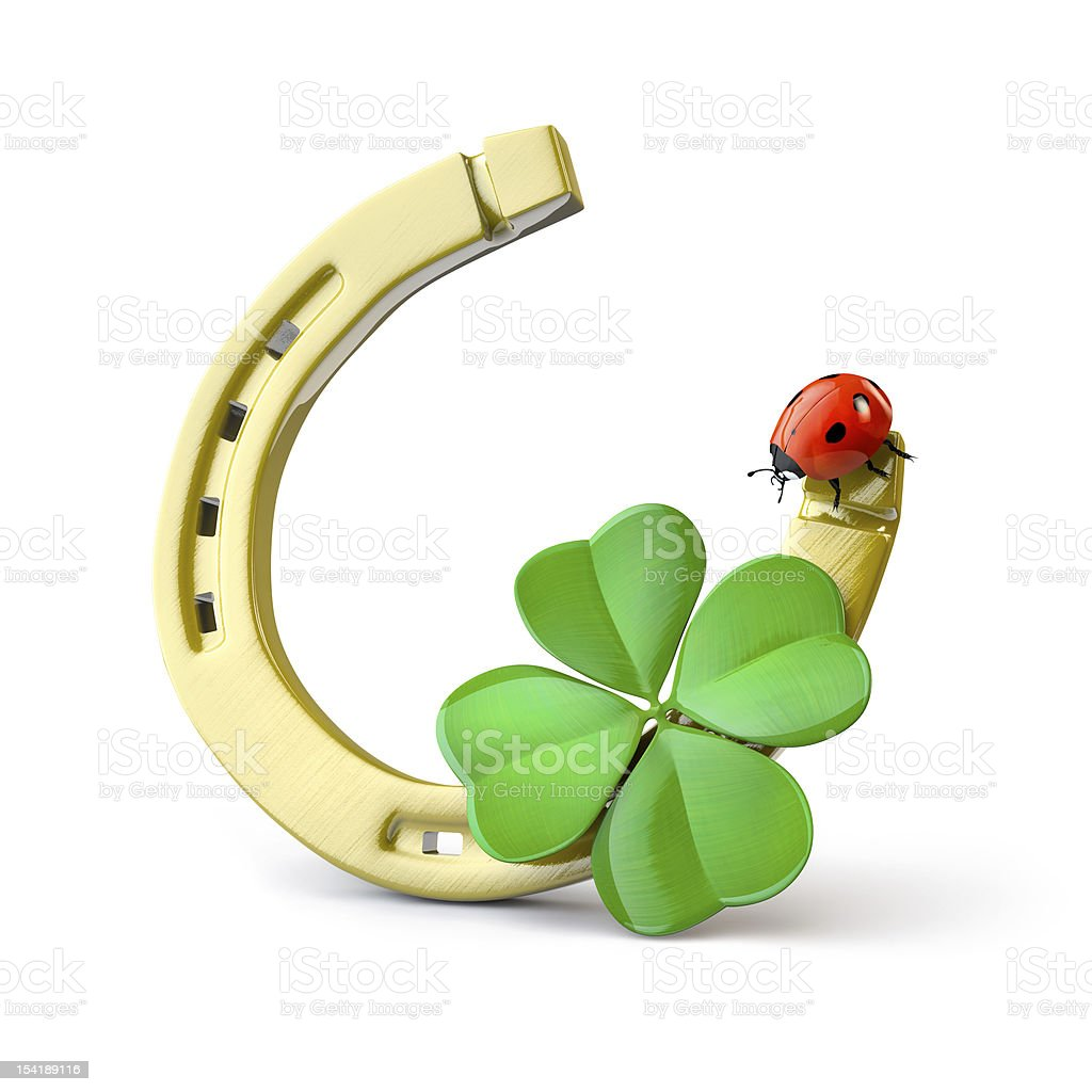 Horseshoe with leaf clover and a ladybug stock photo