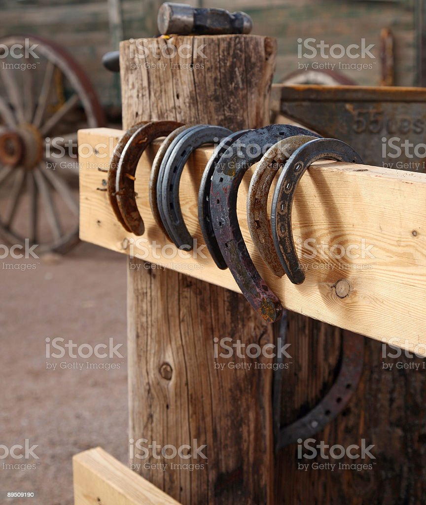 Horseshoes on the fence stock photo
