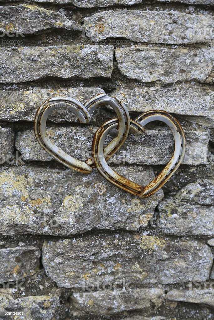 Horseshoes on the wall stock photo