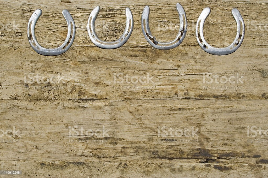 Horseshoes on wood background royalty-free stock photo