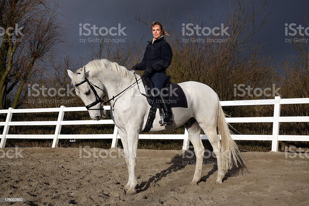 Horsewoman sitting on her horse royalty-free stock photo
