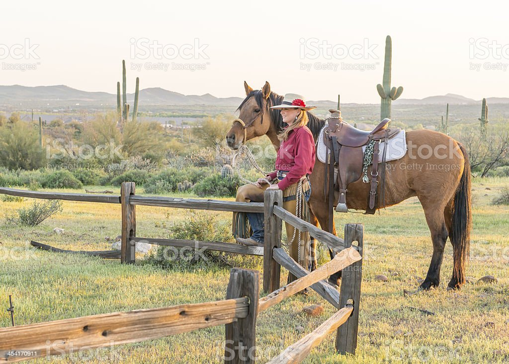 Horsewomans at rail fence stock photo