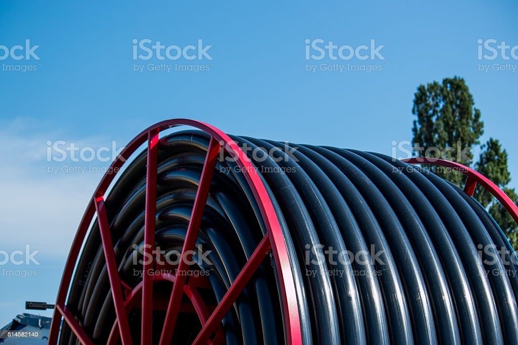 hose reel of  irrigate machine against the sky stock photo