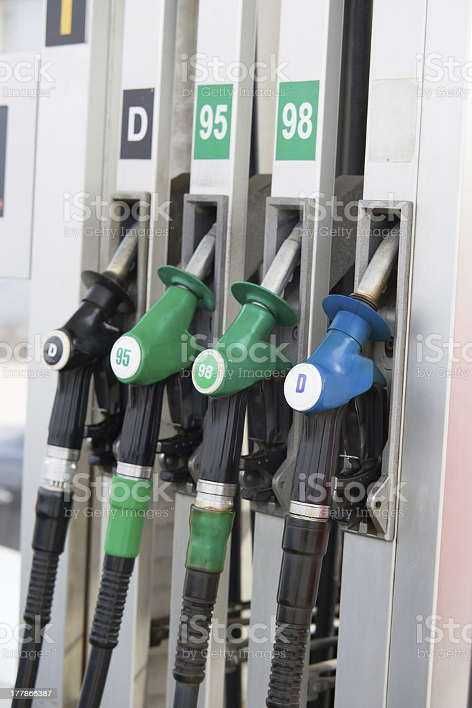 hoses of petrol pump at a gas station stock photo