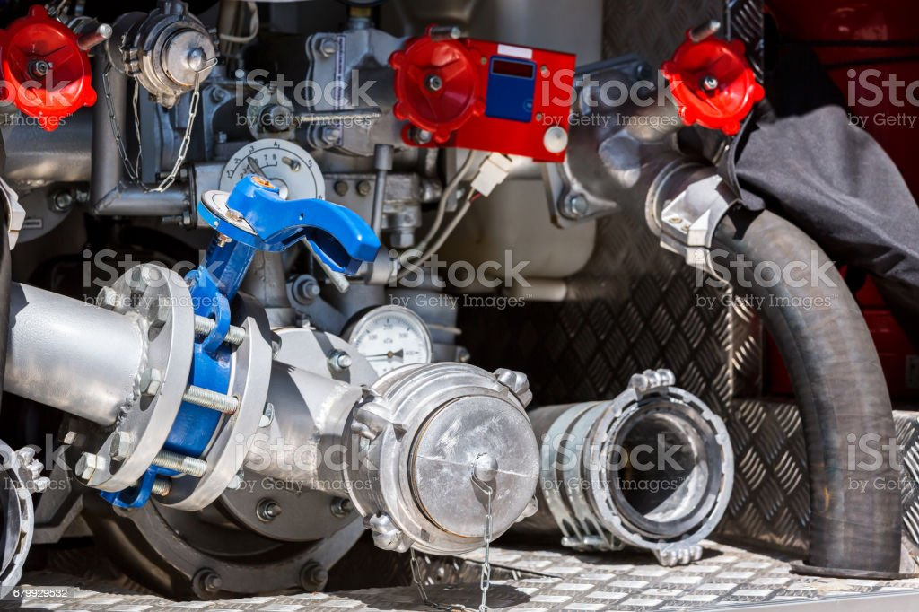 hoses, valves and pressure gauges on rear of fire engine stock photo