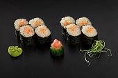 hosomaki sushi rolls decorated with wasabi
