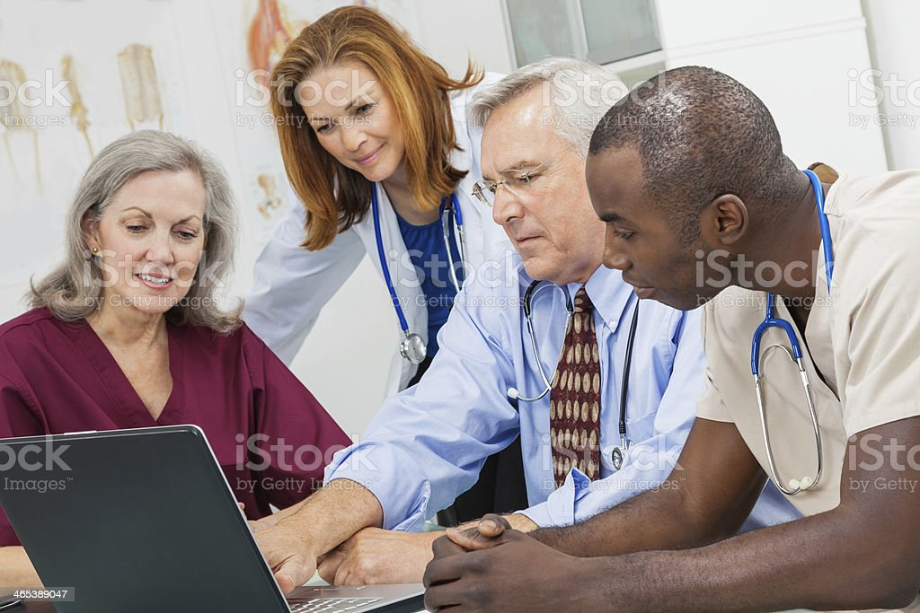 Hospital administrator, doctors, and nurses working together in staff meeting royalty-free stock photo