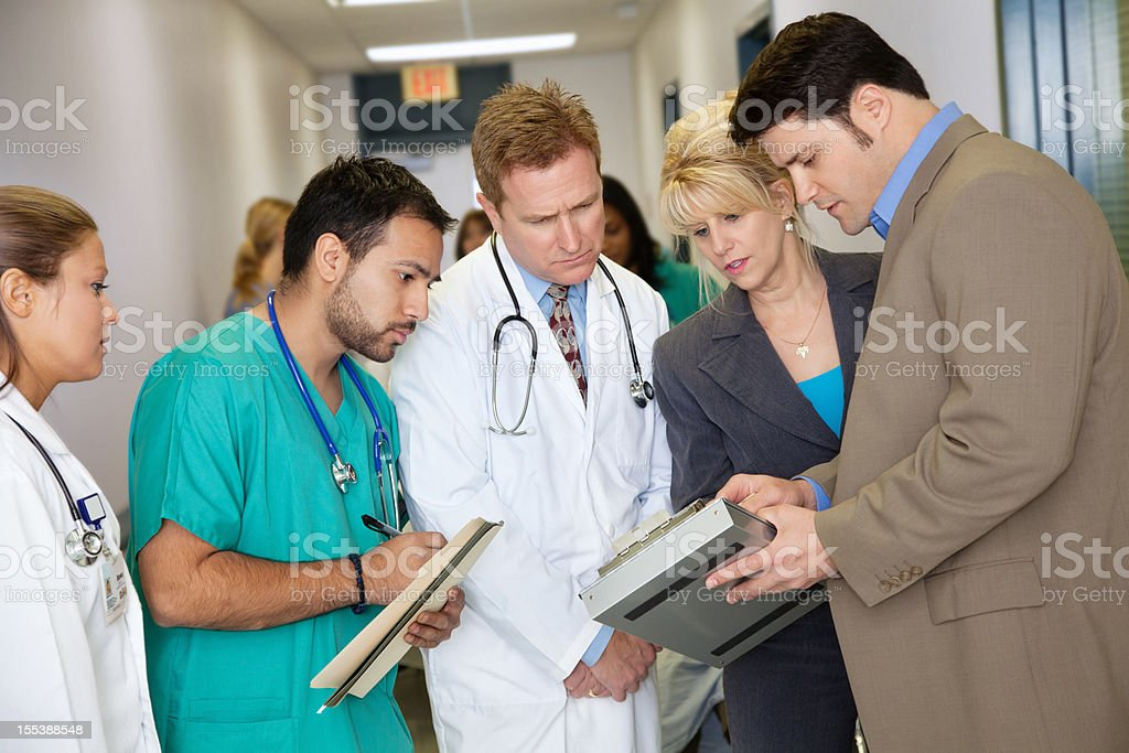Hospital administrators talking to medical staff royalty-free stock photo